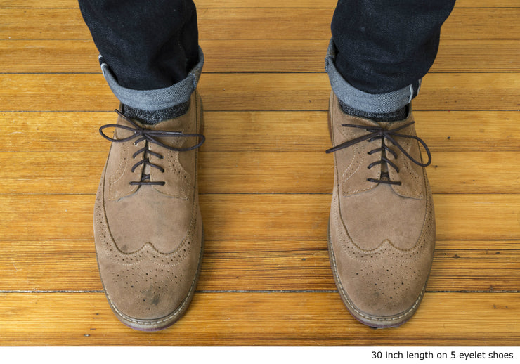 dark-brown-round-waxed-cotton-shoelaces-on-shoes