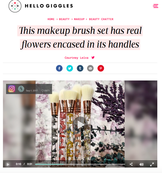 This makeup brush set has real flowers encased in its handles: Hello Giggles Feature