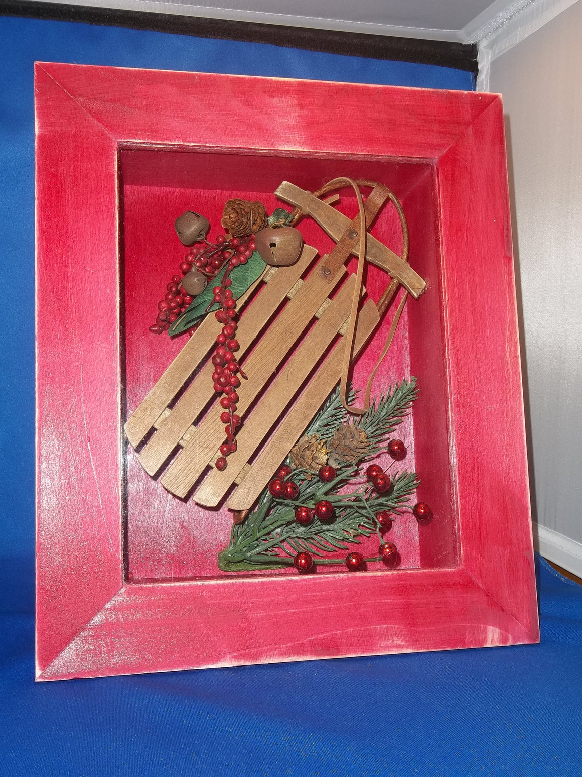 Shadow Box - Framed Red Box with Sled & Greenery (Handcrafted)