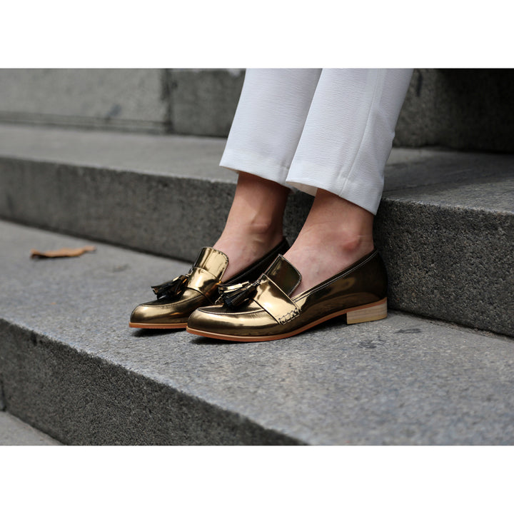 Sarsha Simone wearing EOD Ecstasy metallic bronze loafers