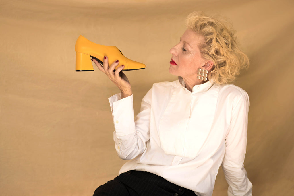 Rose Luker holding up EOD Tara Yellow Leather Pump Heels for In Her Shoes