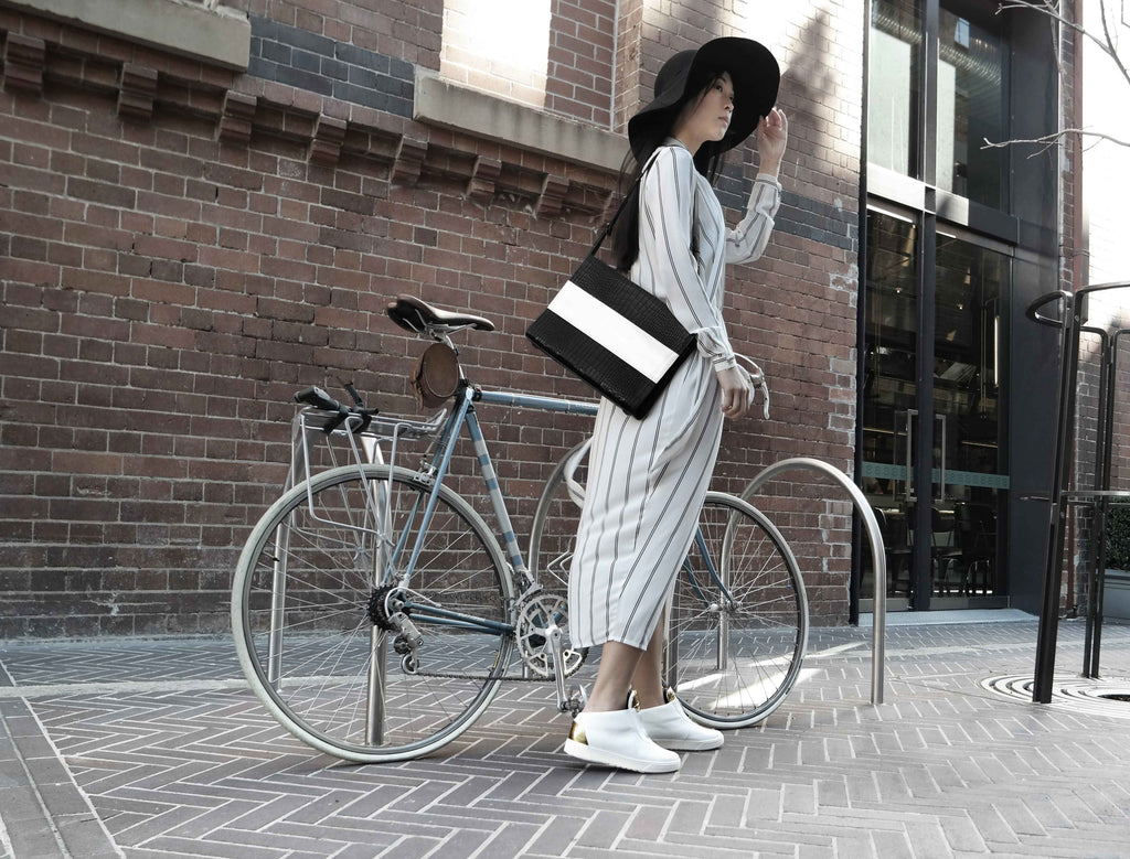 Biking through the city in Kush white sneakers