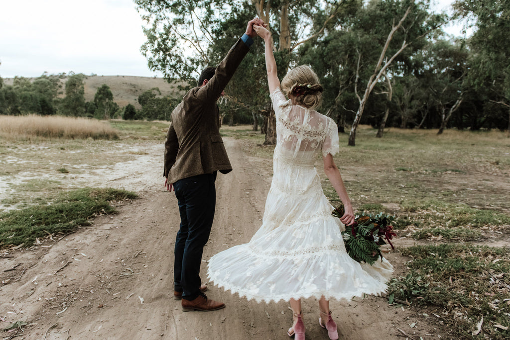 Newlyweds as the bride wears ASHLEY LIM shoes, shot by she takes pictures he makes film
