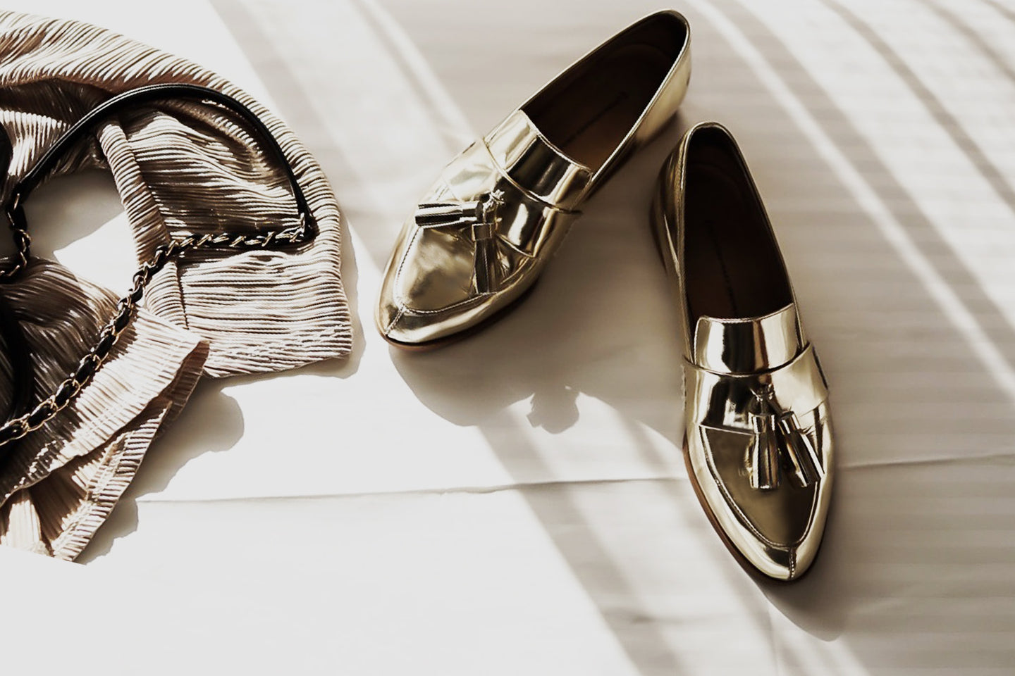 EOD signature Ecstasy tassel loafers in metallic gold by Gabriella