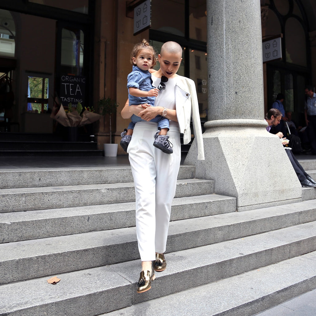Sarsha Simone in EOD by ASHLEY LIM Ecstasy metallic bronze tassel loafers with her son