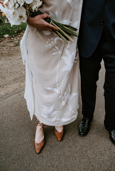 The bride Katia wears Valentina strap brown heels for her wedding with her Leto Bridal wedding dress
