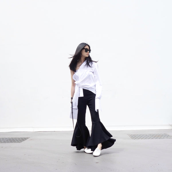 Marilee Pham wearing white Urban Sliders - Slide on women's designer shoes