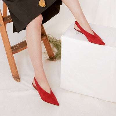 ASHLEY LIM designer shoes for women - Claudette Red Suede Slingback Heels worn with a black skirt