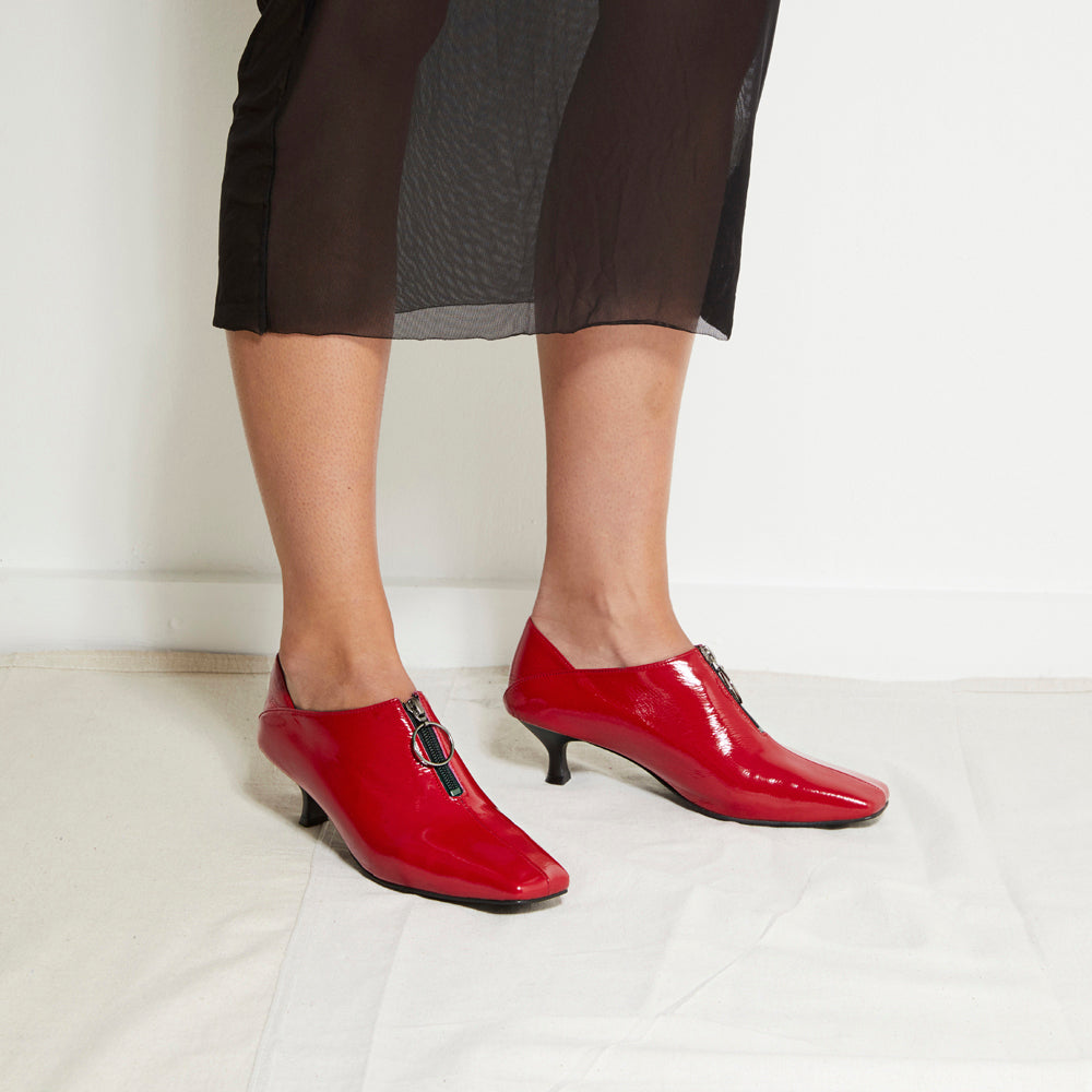 EOD's New Arrival Elle Kitten Heel Pump in Red Patent Leather with Ring Zip worn by model - Women's Designer Shoes
