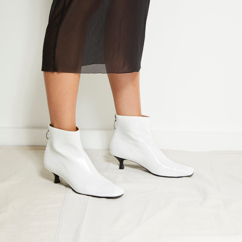 EOD's New Arrival Femme White Kitten Heel Ankle Boots with Ring Zip worn by Model - Women's Designer Shoes