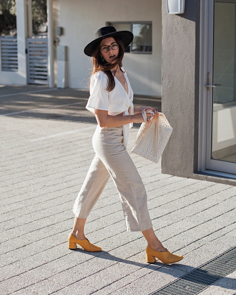 Jenelle Witty of Inspiring Wit's street style wearing Tara yellow wrap pumps
