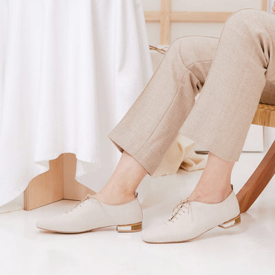 ASHLEY LIM designer shoes for women - MARIE Linen Lace-up Flats styled with neutral beige trousers