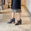 MJ wearing ASHLEY LIM Lagarde black ankle boots with the top folded down