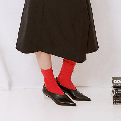 ASHLEY LIM designer shoes for women - VICTORIA Black Leather Pump Heels styled with red socks and a black skirt