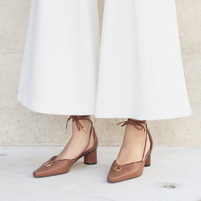ASHLEY LIM designer shoes for women - Valentina Brown Leather Strap Pumps, styled with white wide trousers