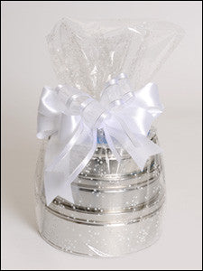 photo of three silver round tins stacked and wrapped in cellophane tied with white ribbon, each tin containing delightful Laura's Brownies or other goodies