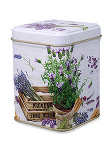 photo of colorfully decorated tall square tin painted with still life scene of flowers and herbs collected in a wooden crate marked Provence - and containing delicious Laura's Brownies
