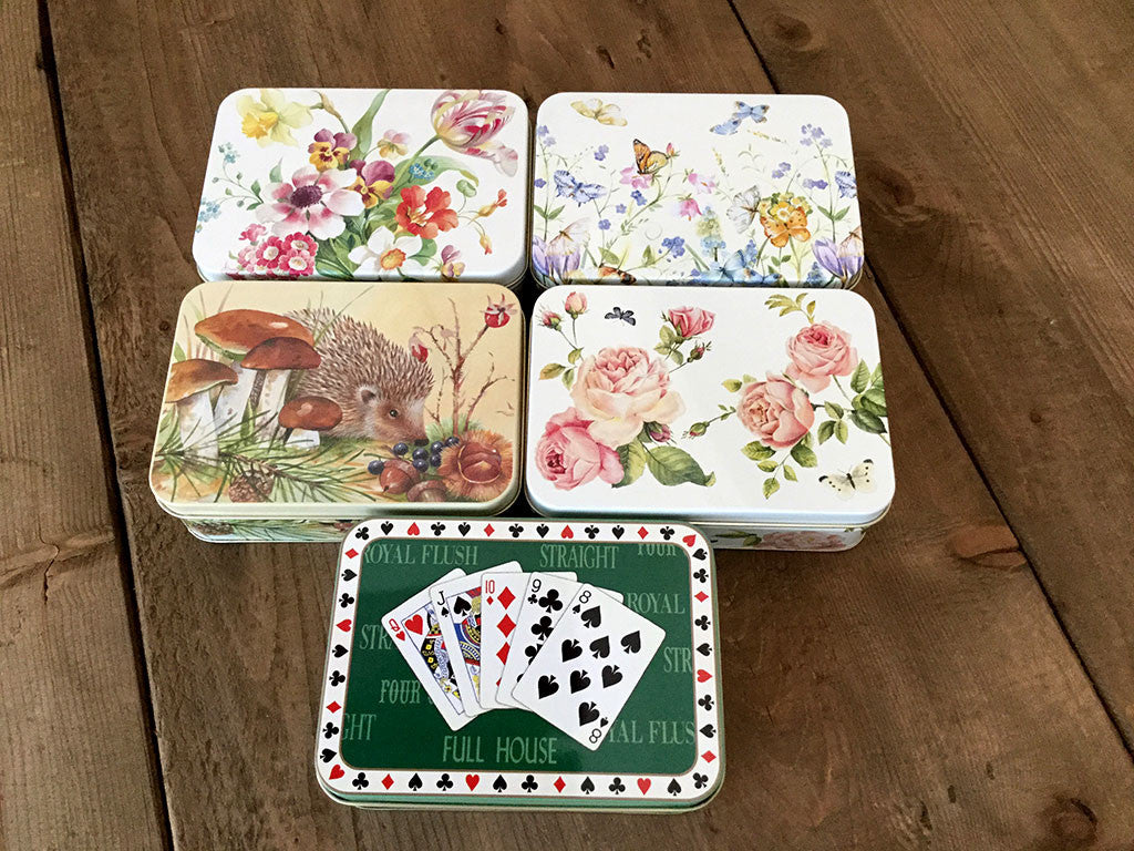 photo of five rectangular colorfully painted tins each containing delicious Laura's Brownies