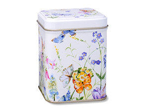 photo of colorfully decorated tall square tin painted white with butterflies and flower blossoms and containing delicious Laura's Brownies or luscious Lemon Bars
