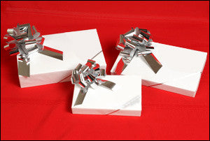 photo of three white gift boxes with big silver bows in small, medium, large each containing fabulous Laura's Brownies