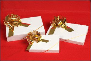 photo of three white gift boxes with big gold bows in small, medium, large each containing fabulous Laura's Brownies
