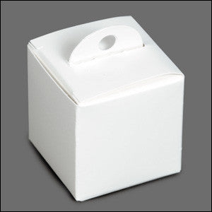 photo of small white paper cube party favor containing Laura's Brownies