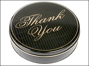 photo of black painted round tin with Thank You in gold script on its lid and containing delightful Laura's Brownies or fabulous Chocolate Chippers