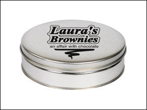 photo of platinum colored round tin box containing delicious Laura's Brownies