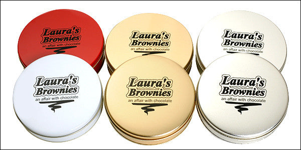 photo of six colorfully colored round tin boxes containing delicious Laura's Brownies