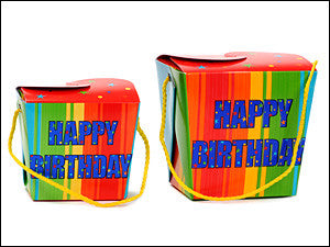 photo of two colorful paper square pint boxes printed with Happy Birthday and containing fabulous Laura's Brownies