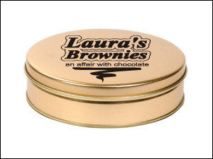 photo of gold colored round tin box containing delicious Laura's Brownies