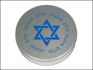 photo of round tin painted silver with Star of David and Shalom in blue containing delicious Laura's Brownies