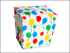 photo of colorful paper square quart box printed with festive balloons and filled with delicious Laura's Brownies