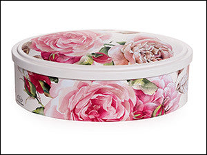 photo of oval tin box painted decoratively with red roses on white and holding delicious Laura's Brownies