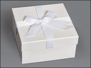 photo of white box with white ribbon and bow containing delightful Laura's Brownies