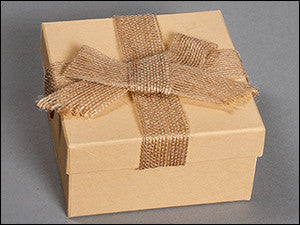 photo of light tan colored box and tan ribbon and bow containing delicious Laura's Brownies