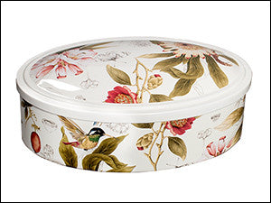 photo of oval tin colorfully decorated with hummingbirds containing delicious Laura's Brownies