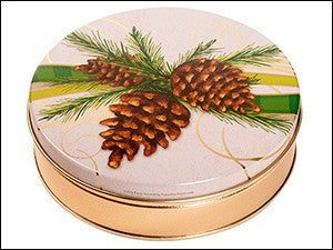 photo of round gold tin with large pinecone on its lid and containing delightful Laura's Brownies