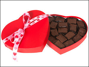 photo of heart-shaped Valentine's Day box with ribbon and filled with delicious Laura's Brownies