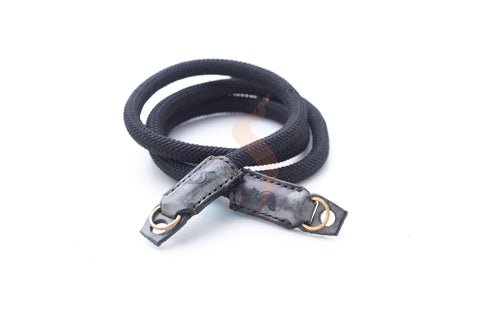 Rope camera strap with waxed camouflage leather.
