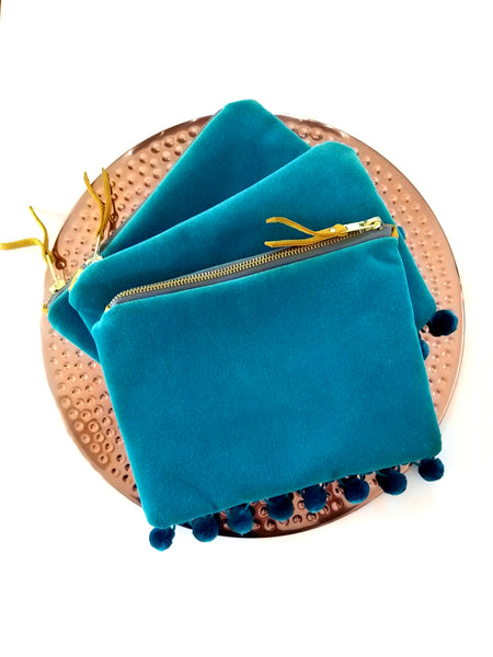Apothaka blue travel bag from mano en mano with upcycled velvet