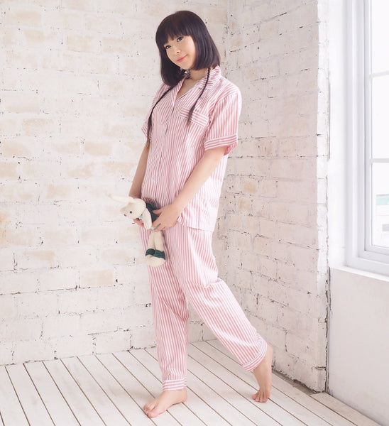 model showing how comfortable is the pink stripes long pants sleepoverpj pajama set