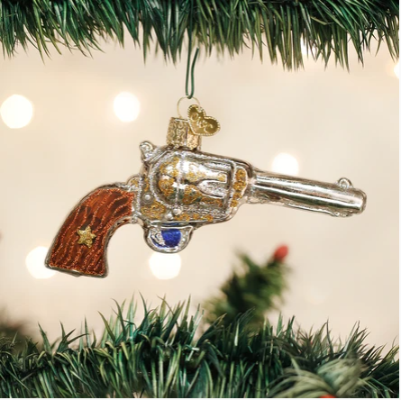 "Old World Christmas ""Western Revolver"" Glass Ornament"