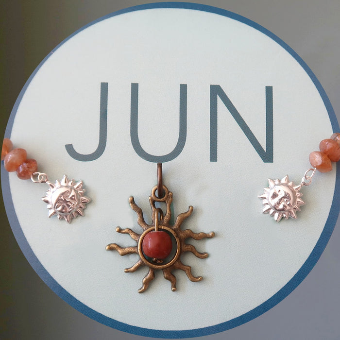 JUN in a circle with sun jewelry pieces