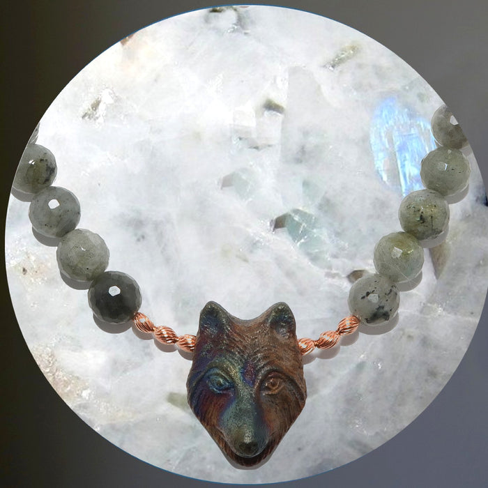 wolf and labradorite necklace around a rainbow moonstone sphere