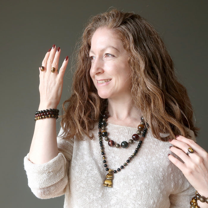 jamie of satin crystals wearing tigers eye rings, bracelets and necklaces