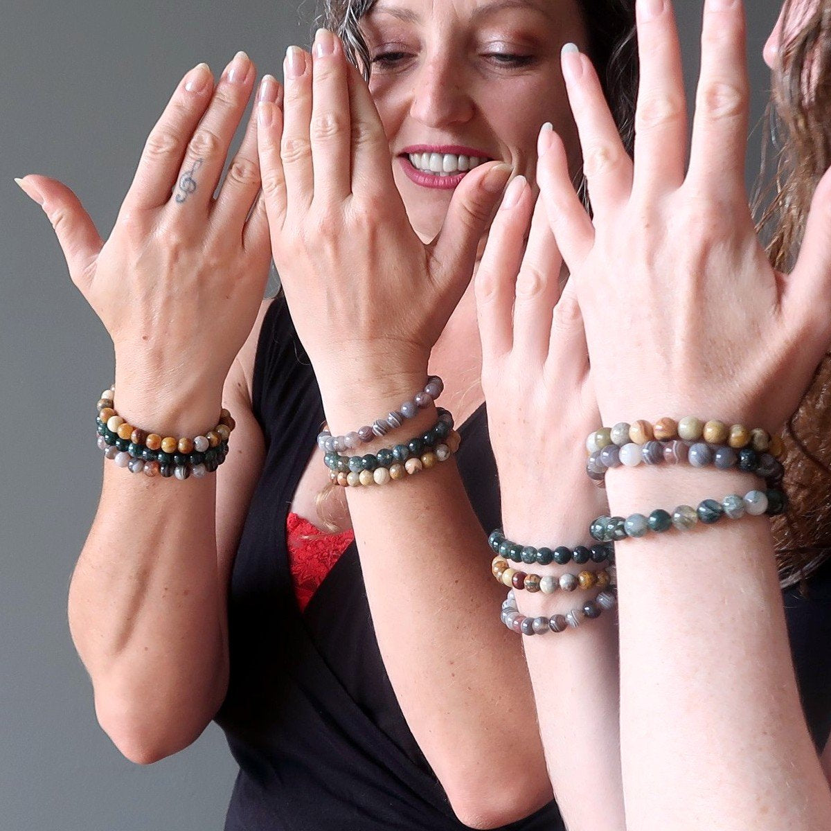 three friends wearing brown smoky quartz beaded stone stretch bracelets