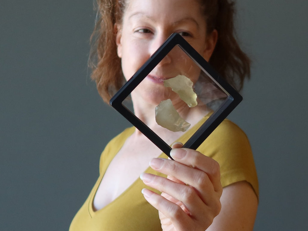 jamie of satin crystals holding libyan desert glass in frame