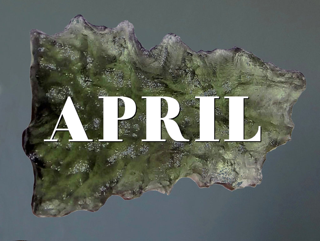 raw moldavite with the word April
