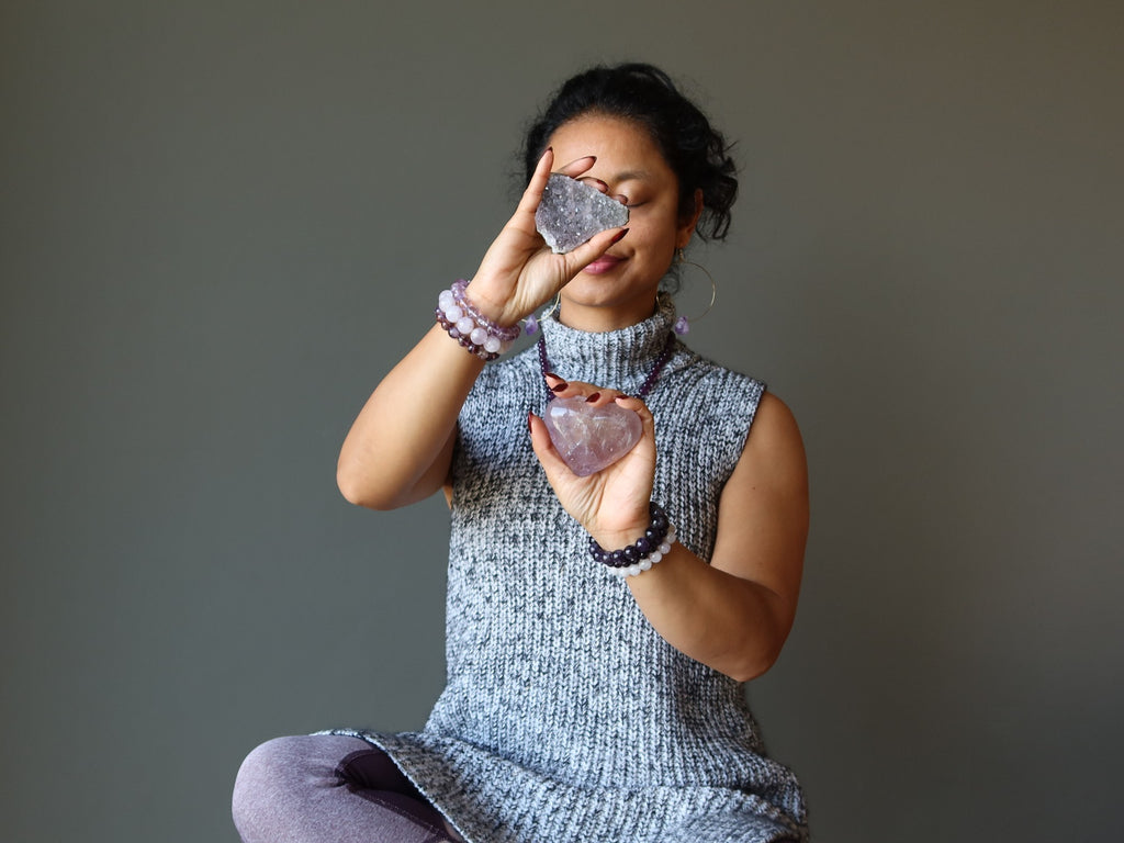 sheila of satin crystals meditating with amethyst stones
